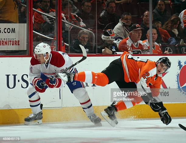 Alexei Emelin of the Montreal Canadiens trips up Matt Read of the Philadelphia Flyers during the first period at the Wells Fargo Center on December...