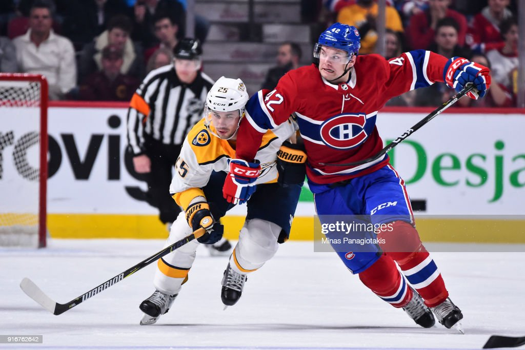 Alexei Emelin #25 of the Nashville Predators and Byron Froese #42 of the Montreal Canadiens skate against each other during the NHL game at the Bell Centre on February 10, 2018 in Montreal, Quebec, Canada. The Nashville Predators defeated the Montreal Canadiens 3-2 in a shootout.