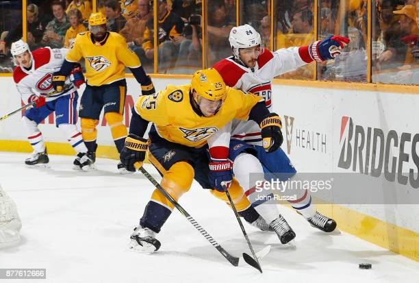 Alexei Emelin of the Nashville Predators battles against Phillip Danault of the Montreal Canadiens during an NHL game at Bridgestone Arena on...