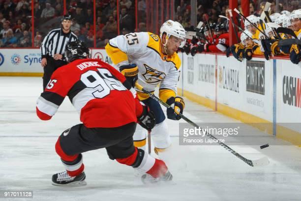 Alexei Emelin of the Nashville Predators shoots the puck against Matt Duchene of the Ottawa Senators at Canadian Tire Centre on February 9 2018 in...