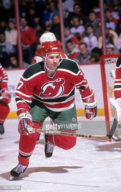Alexei Kasatonov of the New Jersey Devils skates on the ice during an NHL game against the Philadelphia Flyers in September, 1991 at the Spectrum in...