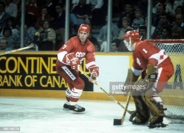Alexei Kasatonov of the USSR skates around the net as teammate goalie Vladimir Myshkin follows the play during the 1982-83 Super Series against the...