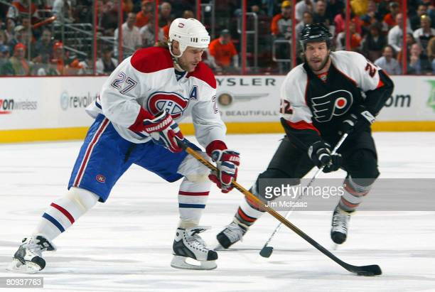 Alexei Kovalev of the Montreal Canadiens handles the puck against Mike Knuble during Game 4 of the Eastern Conference Semifinals of the 2008 NHL...