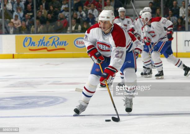 Alexei Kovalev of the Montreal Canadiens moves the puck during the NHL game with the Toronto Maple Leafs at the Air Canada Centre October 8 2005 in...