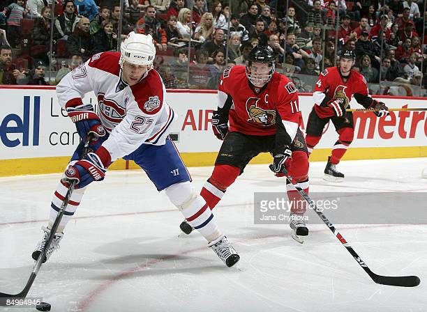 Alexei Kovalev of the Montreal Canadiens stickhandles the puck against Saku Koivu the Ottawa Senators at Bell Centre on February 21 2009 in Montreal...