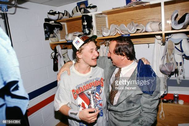 Alexei Kovalev of the New York Rangers celebrates with broadcaster Sam Rosen in the locker room after the Rangers defeated the Vancouver Canucks in...