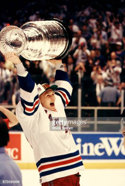 Alexei Kovalev of the New York Rangers skates on the ice with the Stanley Cup Trophy after the Rangers defeated the Vancouver Canucks in Game 7 of...