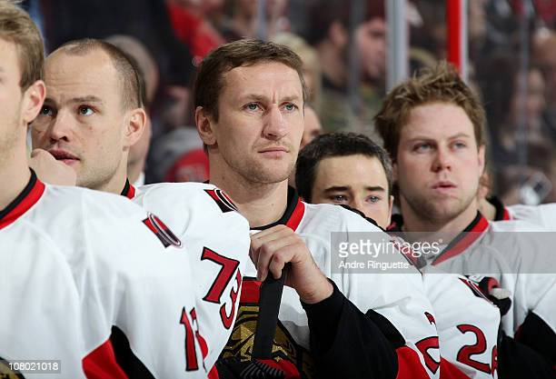 Alexei Kovalev of the Ottawa Senators looks on during the singing of the national anthems prior to a game against the Pittsburgh Penguins at...