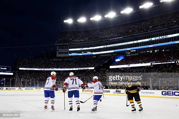 Alexei Kovalev Patrice Brisebois and Oleg Petrov of the Montreal Canadiens celebrate a goal against the Boston Bruins in the Alumni Game on December...