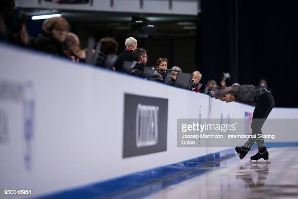 Alexei Krasnozhon of the United States has a word with the judges after a fall in the Junior Men's Free Skating during the World Junior Figure...