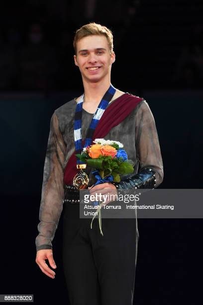 Alexei Krasnozhon of the USA poses on the podium after competing in the junior men free skating during the ISU Junior Senior Grand Prix of Figure...