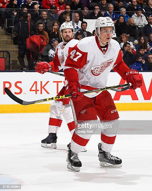 Alexei Marchenko of the Detroit Red Wings turns up ice against the Toronto Maple Leafs during game action on April 2 2016 at Air Canada Centre in...
