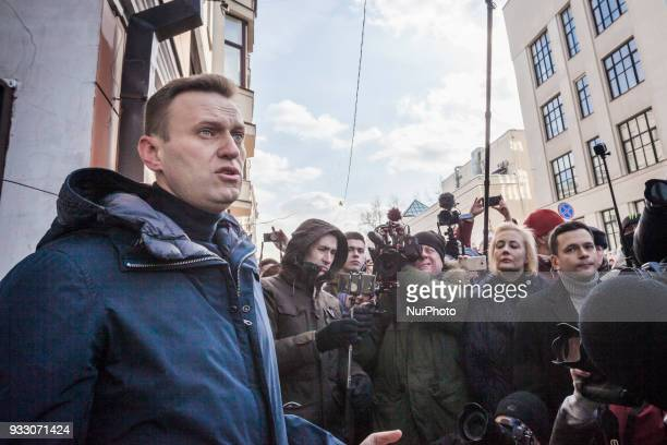 Alexei Navalni russian liberal activist gives a speech during a tribute with flowers in the house where Boris Nemtsov was living politician murdered...