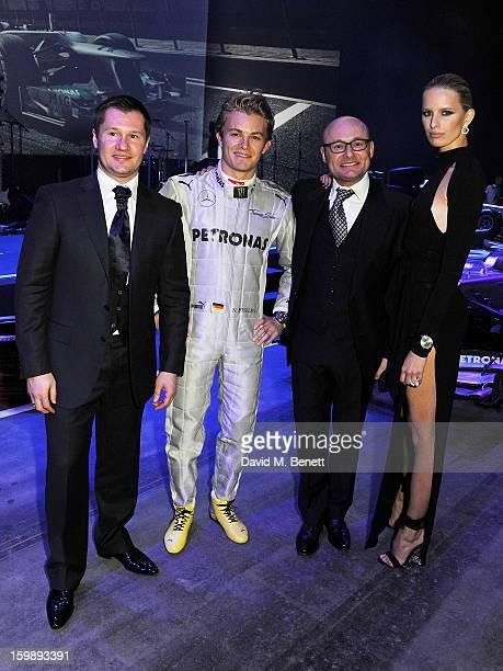 Alexei Nemov, Nico Rosberg, IWC Schaffhausen CEO Georges Kern and Karolina Kurkova attend the IWC Schaffhausen Race Night event during the Salon...