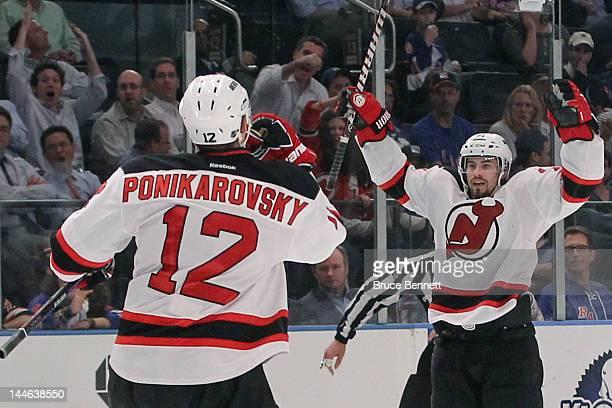 Alexei Ponikarovsky and Adam Henrique of the New Jersey Devils celebrate a  third period goal in 8a0f2fa47
