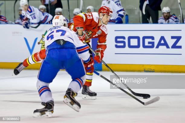 Alexei Ponikarovsky of HC Kunlun Red Star and Yegor Rykov of SKA Saint Petersburg vie for the puck during the 2017/18 Kontinental Hockey League...