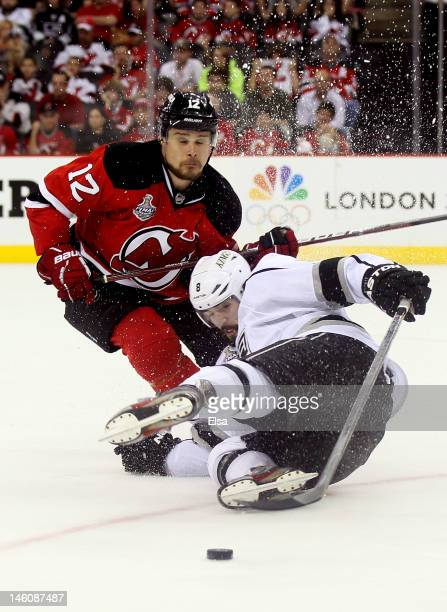 Alexei Ponikarovsky of the New Jersey Devils collides with Drew Doughty of the Los Angeles Kings during Game Five of the 2012 NHL Stanley Cup Final...