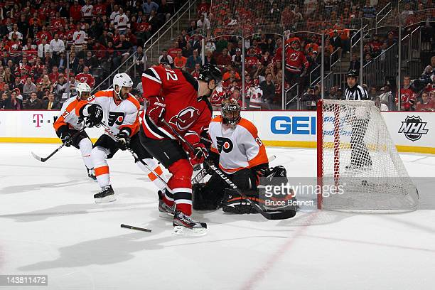 Alexei Ponikarovsky of the New Jersey Devils scores a goal in overtime to defeat the Philadelphia Flyers in Game Three of the Eastern Conference...