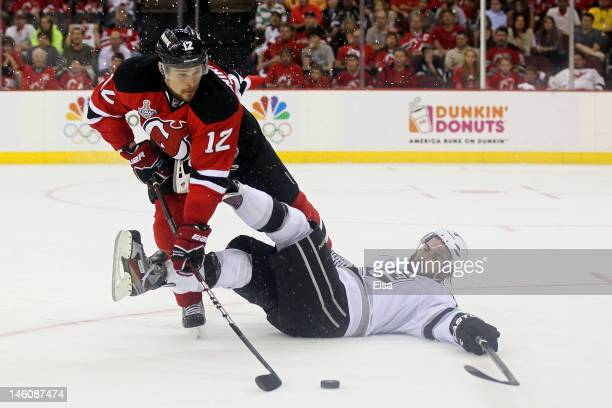Alexei Ponikarovsky of the New Jersey Devils tries to handle the puck  against Drew Doughty of 3fcc684b3