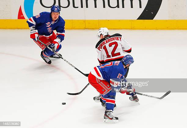 Alexei Ponikarovsky of the New Jersey Devils vies fore the puck with Ruslan  Fedotenko and Brandon 269c24ec2