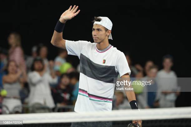 Alexei Popyrin of Australia acknowledges the crowd after victory due to Dominic Thiem of Austria retiring injured during day four of the 2019...