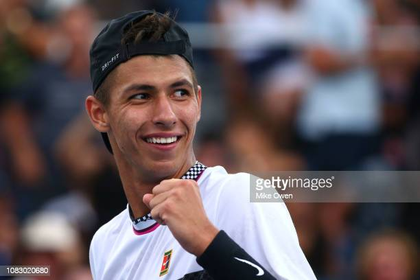 Alexei Popyrin of Australia celebrates after winning match point in his first round match against Mischa Zverev of Germany during day two of the 2019...