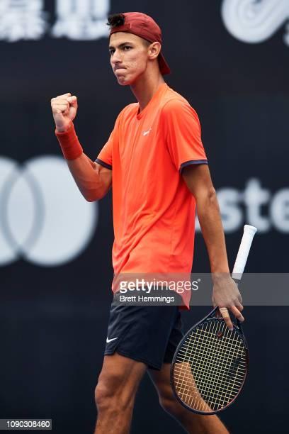 Alexei Popyrin of Australia celebrates winning the second set against Martin Klizan of Slovakia during day one of the 2019 Sydney International at...