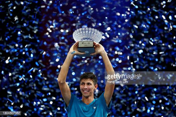 Alexei Popyrin of Australia celebrates with the champion's trophy after his Men's Singles Final match victory over Alexander Bublik of Kazakhstan on...
