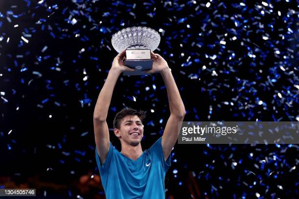 Alexei Popyrin of Australia holds the winner's trophy after his victory in Men's Singles Final match against Alexander Bublik of Kazakhstan on day...