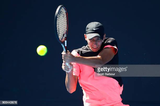 Alexei Popyrin of Australia plays a backhand in his first round match against Tim Smyczek of the United States on day two of the 2018 Australian Open...