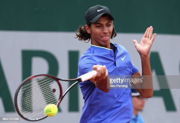 Alexei Popyrin of Australia plays a forehand during boys singles semifinal match against Alejandro Davidovich Fokina of Spain on day thirteen of the...