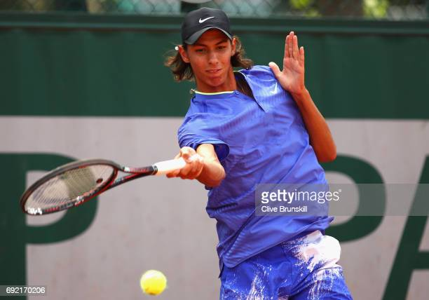 Alexei Popyrin of Australia plays a forehand during the boys singles first round match against Matias Soto of China on day eight of the 2017 French...