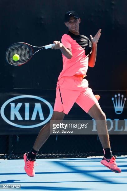 Alexei Popyrin of Australia plays a forehand in his first round match against Tim Smyczek of the United States on day two of the 2018 Australian Open...