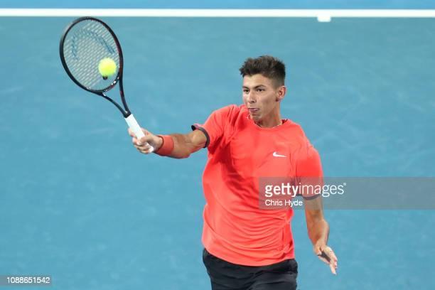 Alexei Popyrin of Australia plays a forehand in his match against Alex de Minaur of Australia during day three of the 2019 Brisbane International at...