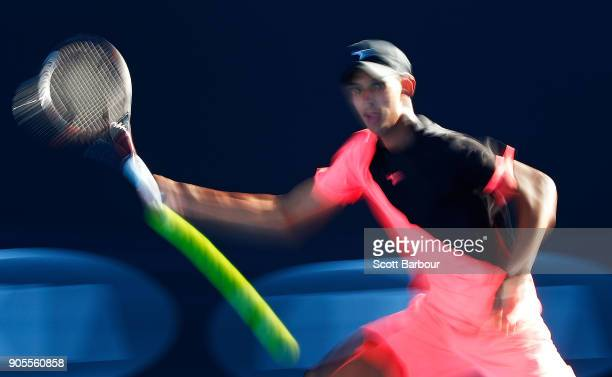 Alexei Popyrin of Australia plays a shot in his first round match against Tim Smyczek of the United States on day two of the 2018 Australian Open at...
