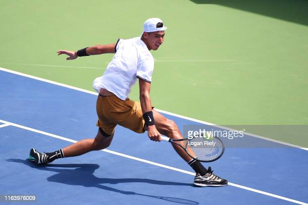 Alexei Popyrin of Australia returns a backhand to PierreHugues Herbert of France during the BBT Atlanta Open at Atlantic Station on July 24 2019 in...