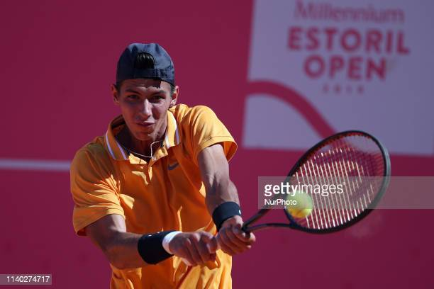 Alexei Popyrin of Australia returns a ball to Joao Sousa of Portugal during the Millennium Estoril Open Day 2 ATP 250 tennis tournament at the Clube...