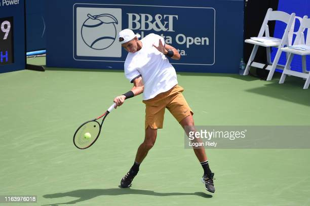 Alexei Popyrin of Australia returns a forehand to PierreHugues Herbert of France during the BBT Atlanta Open at Atlantic Station on July 24 2019 in...