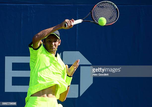 Alexei Popyrin of Australia returns a shot to Lev Kazakov of Russia during his first round Junior Boy's match on Day Seven of the 2016 US Open at the...