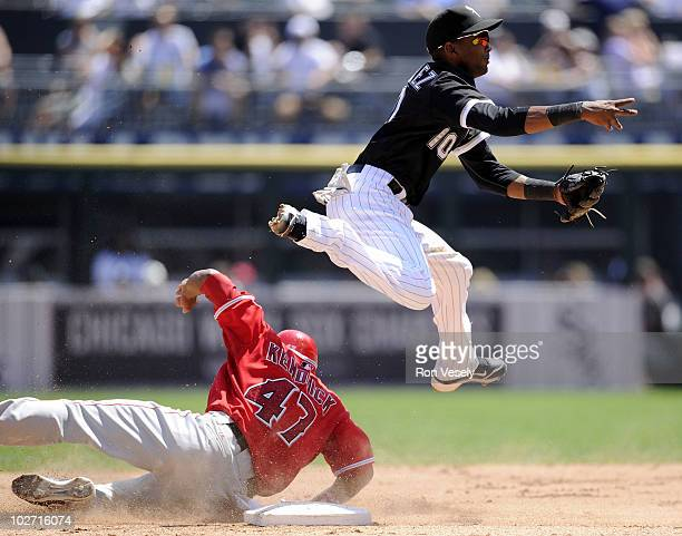 Alexei Rameriz of the Chicago White Sox leaps to avoid the slide of Howard Kendrick of the Los Angeles Angels of Anaheim on July 8 2010 at US...