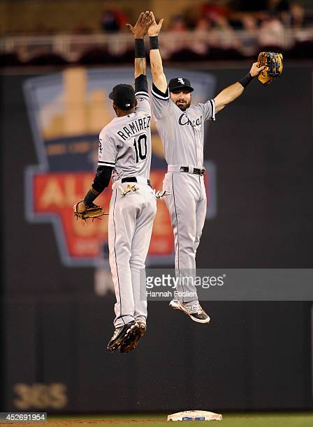 Alexei Ramirez and Adam Eaton of the Chicago White Sox celebrate a win of the game against the Minnesota Twins on July 25 2014 at Target Field in...