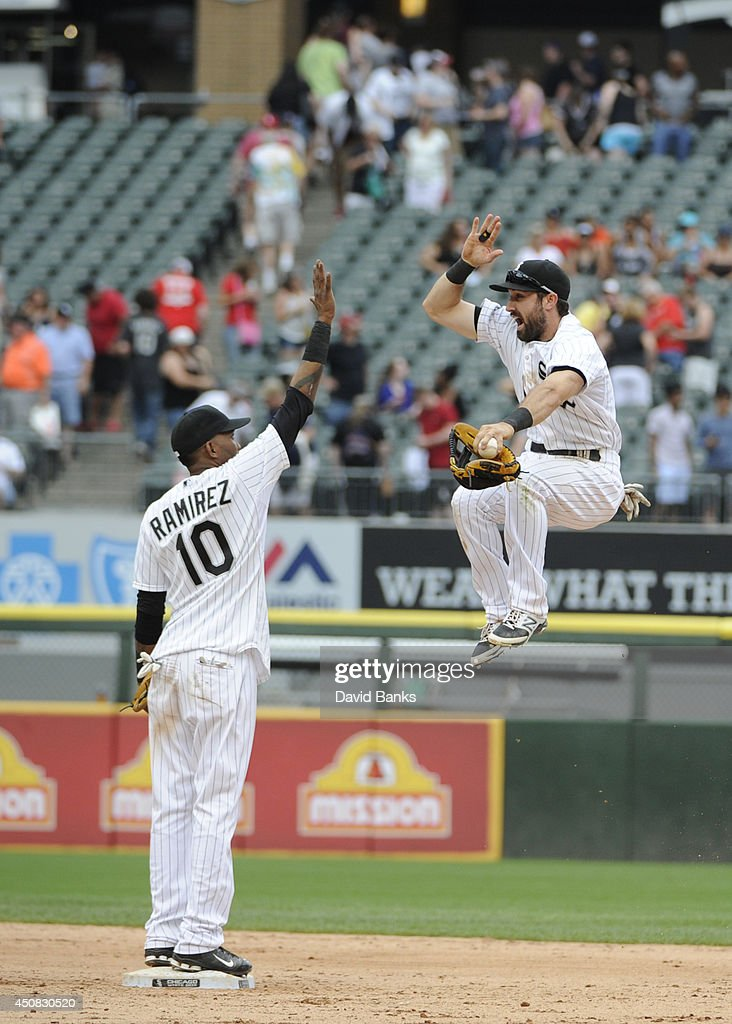 Alexei Ramirez #10 and Adam Eaton #1 of the Chicago White Sox celebrate their win against the San Francisco Giants at U.S. Cellular Field on June 18, 2014 in Chicago, Illinois. The Chicago White Sox defeated the San Francisco Giants 7-6.