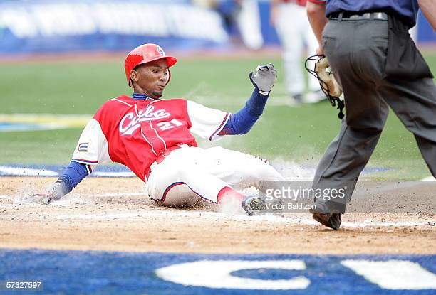 Alexei Ramirez of Cuba slides into home during the game against Panama on March 8, 2006 at Hiram Bithorn Stadium in San Juan, Puerto Rico.