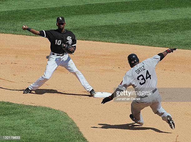 Alexei Ramirez of the Chicago White Sox attempts a double play throw as David Ortiz of the Boston Red Sox runs toward second base at US Cellular...