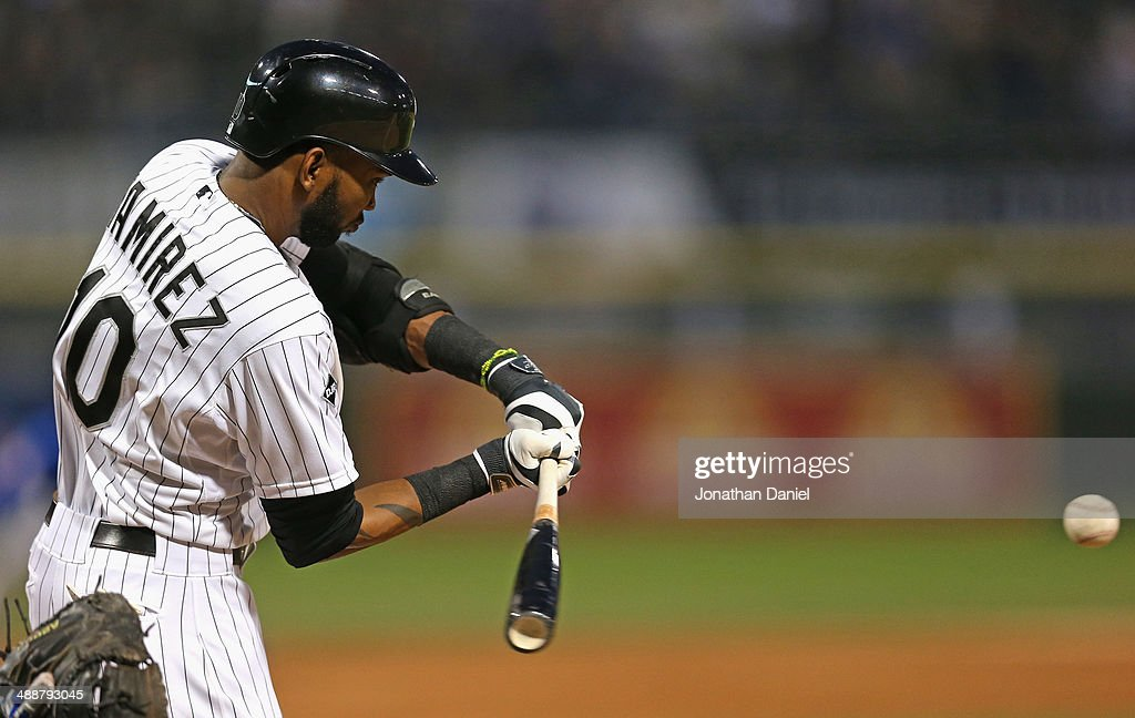 Alexei Ramirez #10 of the Chicago White Sox bats against the Chicago Cubs at U.S. Cellular Field on May 7, 2014 in Chicago, Illinois. The White Sox defeated the Cubs 8-3.