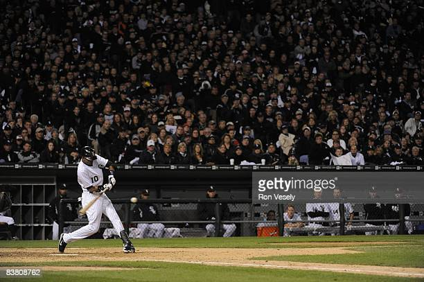 """Alexei Ramirez of the Chicago White Sox bats while 40,142 White Sox fans participate in a """"rolling blackout"""" during the game against the Tampa Bay..."""