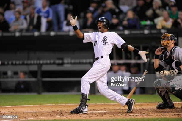 Alexei Ramirez of the Chicago White Sox celebrates as he hits a grand slam in the bottom of the sixth inning to give the White Sox a 6-2 against the...