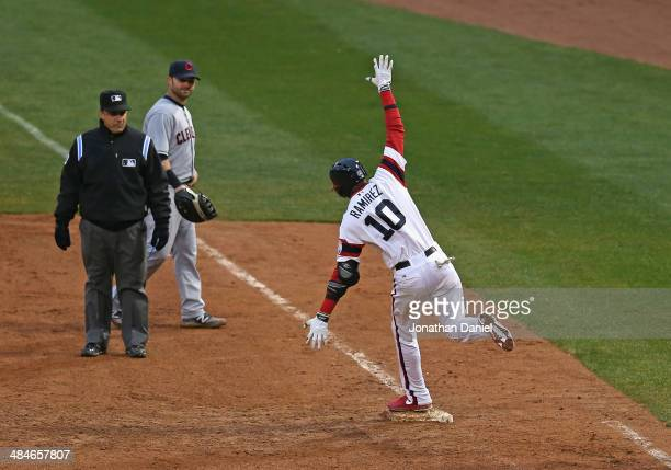 Alexei Ramirez of the Chicago White Sox celebrates hitting a tworun walkoff home run in the bottom of the 9th inning as Nick Swisher of the Cleveland...