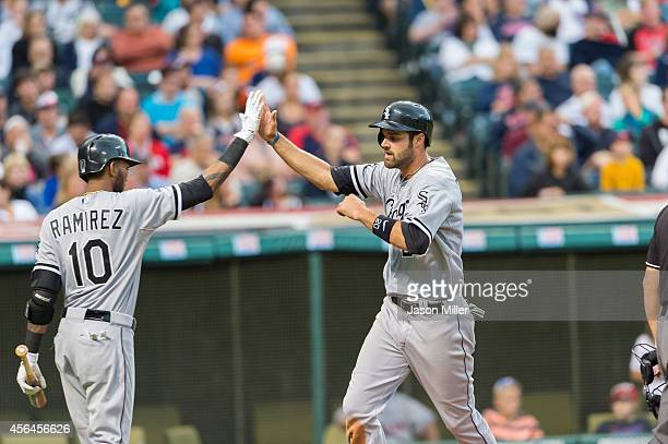 Alexei Ramirez of the Chicago White Sox celebrates with Jordan Danks after Danks scored on a hit by Adam Eaton during the third inning against the...