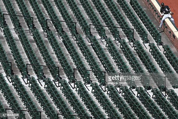 Alexei Ramirez of the Chicago White Sox climbs into the stands before playing the Baltimore Orioles at an empty Oriole Park at Camden Yards on April...